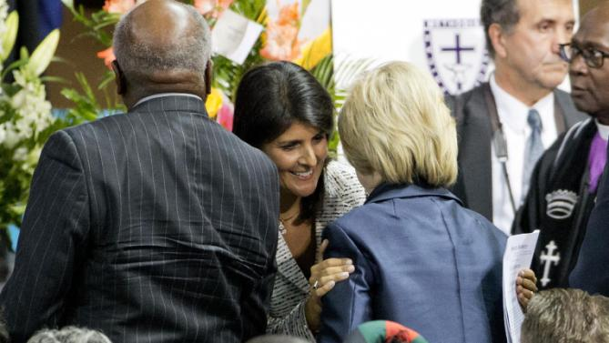 Democratic presidential candidate Hillary Rodham Clinton, right, talks with Gov. Nikki Haley at the funeral service for Rev. Clementa Pinckney, Friday, June 26, 2015, in Charleston, S.C. (AP Photo/David Goldman)