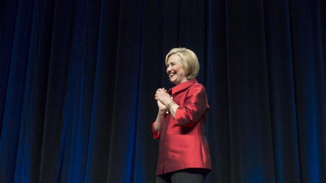 U.S. Democratic presidential candidate Hillary Clinton stands as she is introduced at the Virginia Democratic Party's annual Jefferson-Jackson party fundraising dinner at George Mason University in Fairfax, Virginia, June 26, 2015.      REUTERS/Joshua Roberts