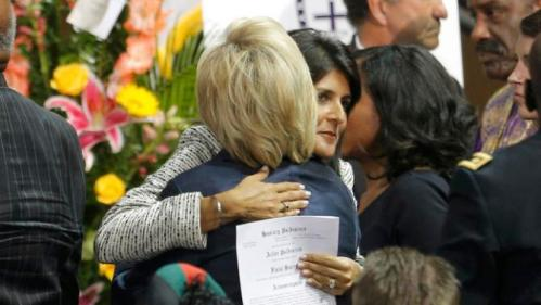 South Carolina Governor Nikki Haley  (L) hugs U.S. Democratic presidential candidate and former Secretary of State Hillary Clinton Clinton after funeral services for the Rev. Clementa Pinckney in Charleston, South Carolina June 26, 2015. Pinckney was one of nine victims of a mass shooting at the Emanuel African Methodist Episcopal Chruch. REUTERS/Brian Snyder
