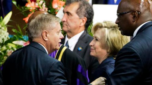 Republican presidential candidate Sen. Lindsey Graham, R-S.C., left, talks with Democratic presidential candidate Hillary Rodham Clinton, right, at the funeral service for Rev. Clementa Pinckney, Friday, June 26, 2015, in Charleston, S.C. (AP Photo/David Goldman)