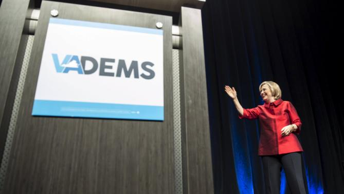U.S. Democratic presidential candidate Hillary Clinton waves at the Virginia Democratic Party's annual Jefferson-Jackson party fundraising dinner at George Mason University in Fairfax, Virginia, June 26, 2015.      REUTERS/Joshua Roberts