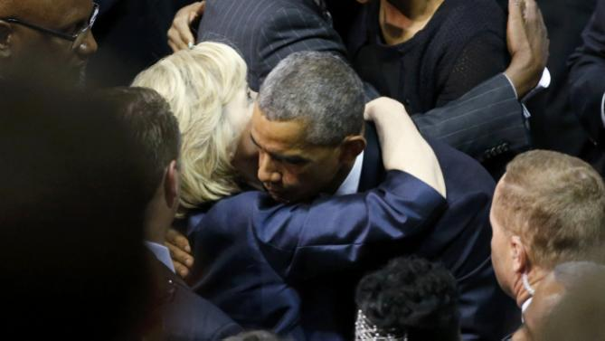 U.S. President Barack Obama hugs Democratic presidential candidate and former Secretary of State Hillary Clinton after  funeral services for the Rev. Clementa Pinckney in Charleston, South Carolina June 26, 2015. Pinckney is one of nine victims of a mass shooting at the Emanuel African Methodist Episcopal Church.   REUTERS/Jonathan Ernst
