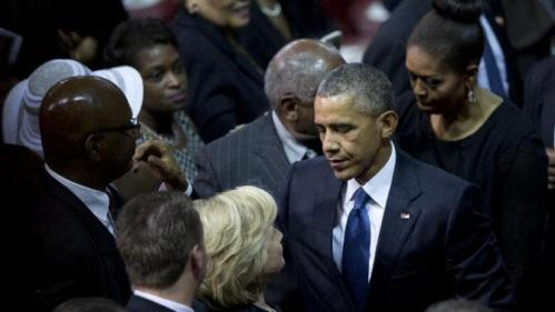 President Barack Obama looks to Democratic presidential candidate, former Secretary of State Hillary Rodham Clinton as he and first lady Michelle Obama leave services honoring the life of Rev. Clementa Pinckney, Friday, June 26, 2015, at the College of Charleston TD Arena, in Charleston, S.C.. Pinckney was one of the nine people killed in the shooting at Emanuel AME Church last week in Charleston. (AP Photo/Carolyn Kaster)
