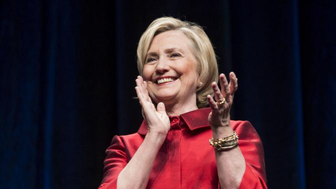 U.S. Democratic presidential candidate Hillary Clinton claps before speaking at the Virginia Democratic Party's annual Jefferson-Jackson party fundraising dinner at George Mason University in Fairfax, Virginia, June 26, 2015. REUTERS/Joshua Roberts