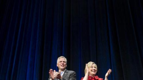 U.S. Democratic presidential candidate Hillary Clinton stands with Virginia Governor Terry McAuliffe before speaking at the Virginia Democratic Party's annual Jefferson-Jackson party fundraising dinner at George Mason University in Fairfax, Virginia, June 26, 2015. REUTERS/Joshua Roberts