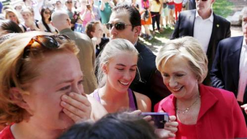 A supporter reacts to having her picture taken with former United States Secretary of State and Democratic candidate for president Hillary Clinton, as Clinton snaps a selfie with another supporter during a campaign event in Hanover, New Hampshire, July 3, 2015.  REUTERS/Dominick Reuter