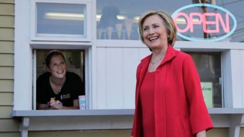 Allison Porreca waits to take Democratic presidential candidate Hillary Rodham Clinton's order for ice cream at Dairy Twirl, Friday, July 3, 2015, in Lebanon, N.H. (AP Photo/Elise Amendola)