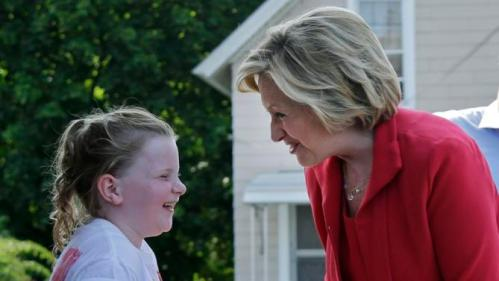 Democratic presidential candidate Hillary Rodham Clinton laughs with Sage Murray, 8, at Dairy Twirl ice cream, Friday, July 3, 2015, in Lebanon, N.H. (AP Photo/Elise Amendola)