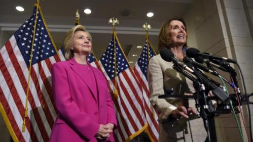 Democratic presidential candidate Hillary Rodham Clinton listens at left as House Minority Leader Nancy Pelosi of Calif. speaks to reporters on Capitol Hill in Washington, Tuesday, July 14, 2015. Clinton, who spoke to reporters on the deal reached with Iran, attended meetings on Capitol Hill with House and Senate Democrats. (AP Photo/Susan Walsh)