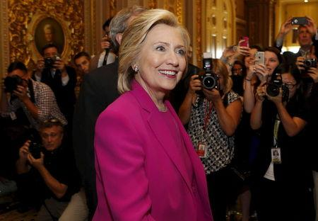 U.S. Democratic Presidential candidate Hillary Clinton arrives at the Senate Democratic weekly policy luncheon on Capitol Hill in Washington July 14, 2015. REUTERS/Yuri Gripas
