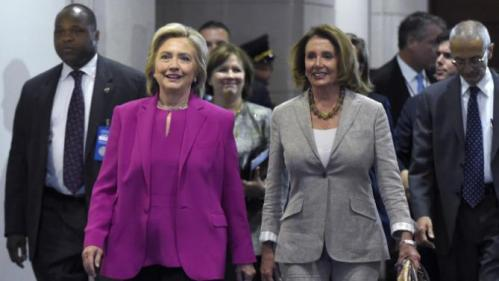 Democratic presidential candidate Hillary Rodham Clinton walks with House Minority Leader Nancy Pelosi of Calif. on Capitol Hill in Washington, Tuesday, July 14, 2015. Clinton is attend meetings on Capitol Hill with House and Senate Democrats. (AP Photo/Susan Walsh)