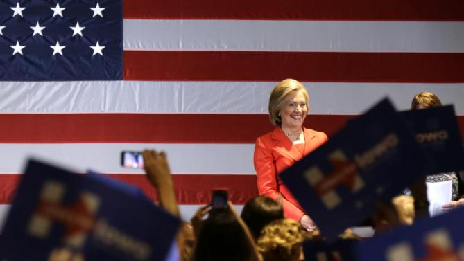 Democratic presidential candidate Hillary Rodham Clinton smiles at supporters during a rally before the Iowa Democratic Party's Hall of Fame Dinner, Friday, July 17, 2015, in Cedar Rapids, Iowa. (AP Photo/Charlie Neibergall)