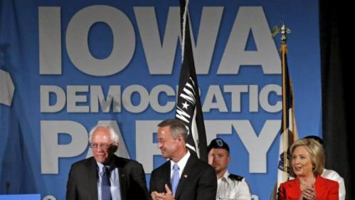 U.S. Democratic presidential candidates Hillary Clinton (R) is joined on stage by Martin O'Malley (C) and Bernie Sanders for the Iowa Democratic Party's Hall of Fame dinner in Cedar Rapids, Iowa, United States, July 17, 2015. REUTERS/Jim Young