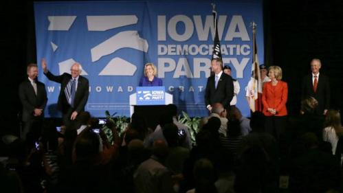 Democratic presidential candidates Jim Webb, from left, Bernie Sanders, Martin O'Malley, Hillary Rodham Clinton and Lincoln Chafee, right, stand on stage together as they are introduced by Iowa Democratic Party Chair Dr. Andy McGuire, center, during the Iowa Democratic Party's Hall of Fame Dinner, Friday, July 17, 2015, in Cedar Rapids, Iowa. (AP Photo/Charlie Neibergall)