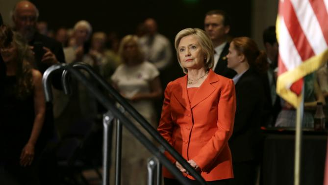 Democratic presidential candidate Hillary Rodham Clinton looks on as she is introduced to speak during the Iowa Democratic Party's Hall of Fame Dinner, Friday, July 17, 2015, in Cedar Rapids, Iowa. (AP Photo/Charlie Neibergall)