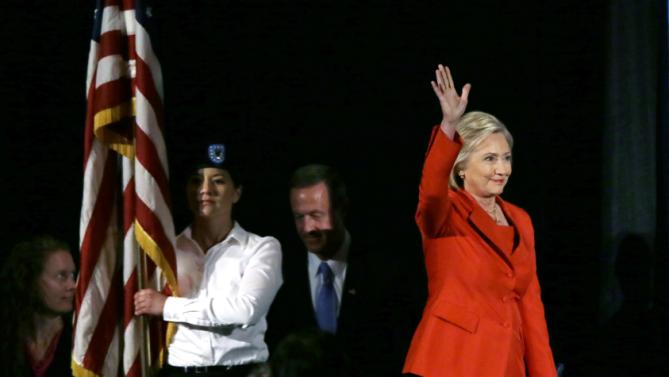 Democratic presidential candidate Hillary Rodham Clinton waves to supporters as she walks on stage during the Iowa Democratic Party's Hall of Fame Dinner, Friday, July 17, 2015, in Cedar Rapids, Iowa. (AP Photo/Charlie Neibergall)