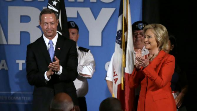 Democratic presidential candidates former Maryland Gov. Martin O'Malley and Hillary Rodham Clinton stand on stage during the Iowa Democratic Party's Hall of Fame Dinner, Friday, July 17, 2015, in Cedar Rapids, Iowa. (AP Photo/Charlie Neibergall)
