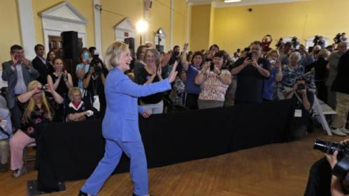 Democratic presidential candidate Hillary Rodham Clinton waves as she arrives for a town hall meeting in Dover, N.H., Thursday, July 16, 2015. (AP Photo/Charles Krupa)