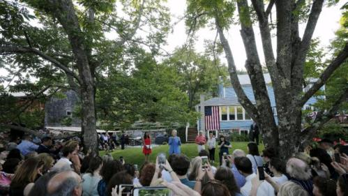 Democratic presidential candidate Hillary Clinton speaks during a campaign stop in a back yard of a home in Windham, New Hampshire July 16, 2015. REUTERS/Brian Snyder