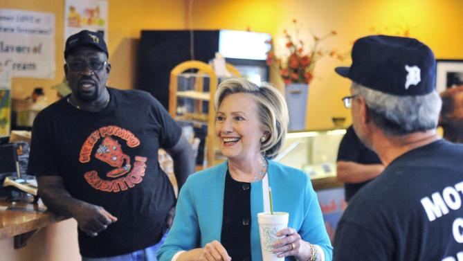Democratic presidential candidate Hillary Rodham Clinton mades a stop at the popular Sweet Potato Sensations bake shop in Detroit on Tuesday, July 21, 2015.  Clinton stopped in ahead of a $2,700-a-head fundraiser in the suburbs. (Daniel Mears/Detroit News via AP)  DETROIT FREE PRESS OUT; HUFFINGTON POST OUT; MANDATORY CREDIT
