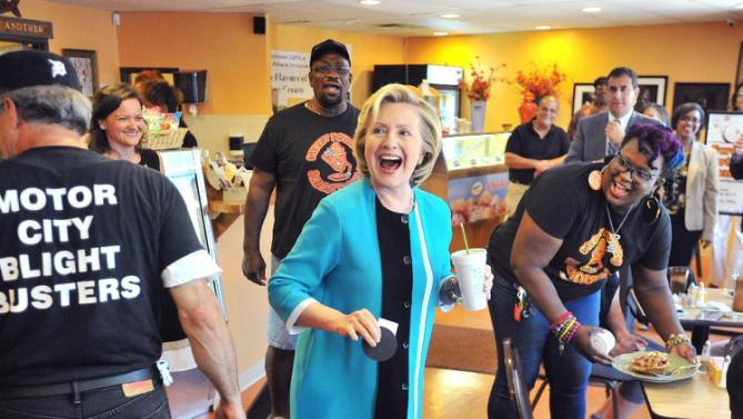 Democratic presidential candidate Hillary Rodham Clinton laughs Tuesday, July 21, 2015 at Sweet Potato Sensations bake shop in Detroit.  Clinton stopped in ahead of a $2,700-a-head fundraiser in the suburbs. (Daniel Mears/Detroit News via AP)  DETROIT FREE PRESS OUT; HUFFINGTON POST OUT; MANDATORY CREDIT