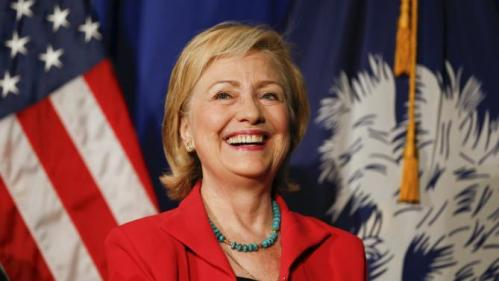 U.S. Democratic presidential candidate Hillary Clinton smiles as she is introduced during a campaign event in West Columbia, South Carolina July 23, 2015. REUTERS/Chris Keane