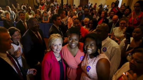 U.S. Democratic presidential candidate Hillary Clinton stops for a picture with supporters after a campaign stop in West Columbia, South Carolina July 23, 2015. REUTERS/Chris Keane
