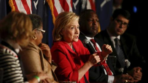 U.S. Democratic presidential candidate Hillary Clinton speaks as she is surrounded by local mayors in West Columbia, South Carolina July 23, 2015. REUTERS/Chris Keane