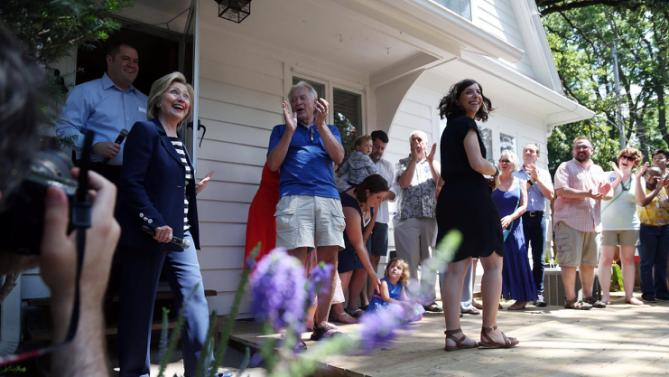 Presidential hopeful Hillary Clinton makes her entrance to Sean Bagniewski and Vidhya Reddy's backyard for a campaign event on Saturday, July 25, 2015 in Beaverdale, Iowa.  (Kelsey Kremer/The Des Moines Register via AP)