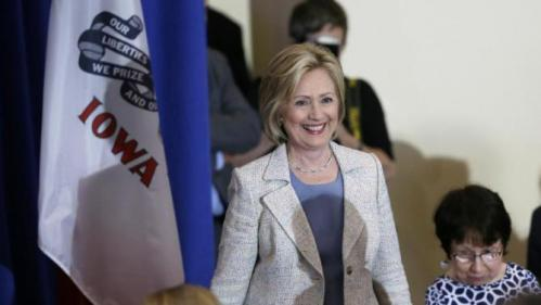 Democratic presidential candidate Hillary Rodham Clinton smiles as she enters a campaign event Sunday, July 26, 2015, at Iowa State University in Ames, Iowa. (AP Photo/Charlie Neibergall)