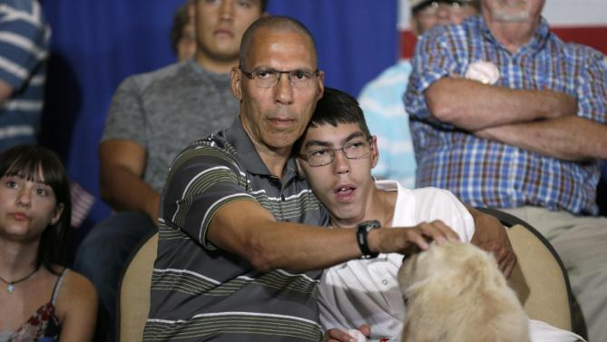 Dale Todd and his son Adam listen to Democratic presidential candidate Hillary Rodham Clinton speak during a campaign event Sunday, July 26, 2015, at Iowa State University in Ames, Iowa. (AP Photo/Charlie Neibergall)