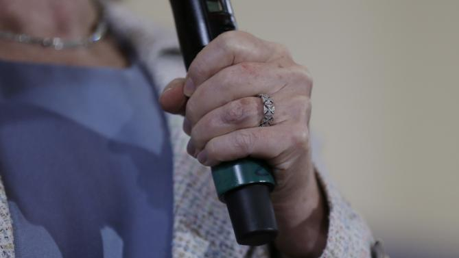 Democratic presidential candidate Hillary Rodham Clinton's ring is seen as she speaks at a campaign event, Sunday, July 26, 2015, at Iowa State University in Ames, Iowa. (AP Photo/Charlie Neibergall)