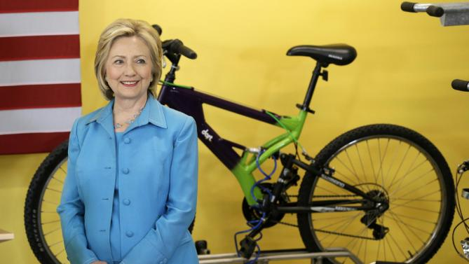 Democratic presidential candidate Hillary Rodham Clinton looks on as she is introduced to speak about her renewable energy plan, Monday, July 27, 2015, at the Des Moines Area Rapid Transit Central Station in Des Moines, Iowa. (AP Photo/Charlie Neibergall)