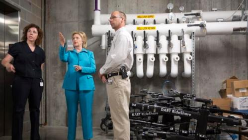Democratic presidential hopeful Hillary Clinton (C) tours the geothermal system during a visit to the LEED Platinum certified DART Central Station in Des Moines, Iowa July 27, 2015. General Manager Elizabeth Presutti (L) and Building Superintendent Keith Welch (R) conduct the tour.   REUTERS/Scott Morgan