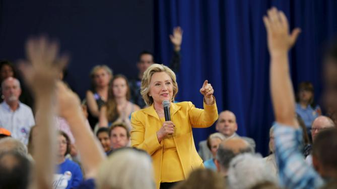 Democratic presidential candidate Hillary Clinton takes a question from the audience during a town hall campaign stop in Nashua, New Hampshire July 28, 2015.  REUTERS/Brian Snyder