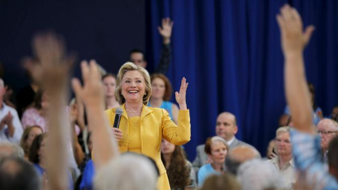 Democratic presidential candidate Hillary Clinton reacts to the show of hands in the audience with questions during a town hall campaign stop in Nashua, New Hampshire July 28, 2015.  REUTERS/Brian Snyder