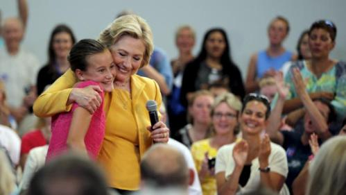 Democratic presidential candidate Hillary Clinton hugs ten year-old Emily Wall, after Wall asked to shake the hand of the first female President of the United States, during town hall campaign event in Nashua, New Hampshire July 28, 2015. REUTERS/Brian Snyder
