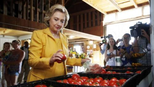 Democratic presidential candidate Hillary Rodham Clinton gets fresh tomatoes at Dimond Hill Farm between campaign stops Tuesday, July 28, 2015, in Hopkinton, N.H. (AP Photo/Jim Cole)