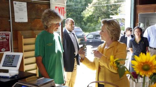 Democratic presidential candidate Hillary Rodham Clinton talks with Jane Presby owner of Dimond Hill Farm during  stop Tuesday, July 28, 2015, in Hopkinton, N.H. (AP Photo/Jim Cole)