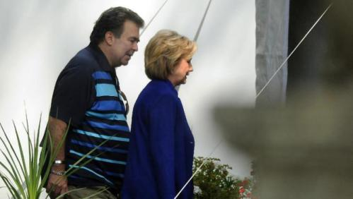 Presidential candidate Hillary Clinton walks with her brother Hugh Rodham during a private fundraiser at the home of long time supporter Virginia McGregor in the Green Ridge section of Scranton, Pa., on Wednesday, July 29, 2015. The event was closed to the media.  (Butch Comegys /The Times & Tribune via AP) WILKES BARRE TIMES-LEADER OUT; MANDATORY CREDIT