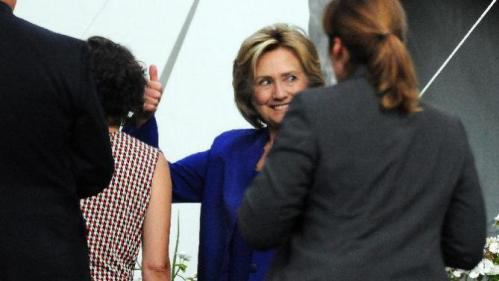 Presidential candidate Hillary Rodham Clinton gestures with a smile after speaking during a private fundraiser at the home of long time supporter Virginia McGregor in the Green Ridge section of Scranton, Pa., on Wednesday, July 29, 2015. The event was closed to the media. (Butch Comegys /The Times & Tribune via AP) WILKES BARRE TIMES-LEADER OUT; MANDATORY CREDIT