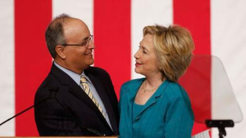 Democratic U.S presidential candidate Hillary Clinton (R) is introduced by Frank O. Mora, director of the Latin American and Caribbean Center at Florida International University, before her speech on Cuban relations in Miami, Florida July 31, 2015. Clinton on Friday called for the U.S. Congress to end the U.S. economic embargo in Cuba and said she would make it easier for Americans to travel to the Communist-led island if she were president. REUTERS/Joe Skipper