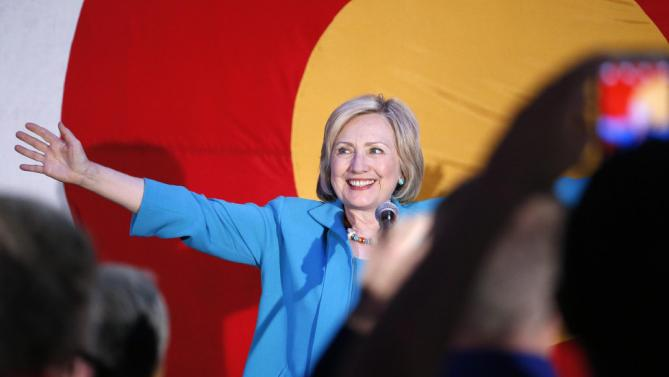 Democratic presidential candidate Hillary Rodham Clinton greets supporters before speaking at a campaign rally at La Rumba, a Denver dance club and restaurant, Tuesday, Aug. 4, 2015. The rally marks Clinton's first presidential campaign event in Denver. (AP Photo/Brennan Linsley)