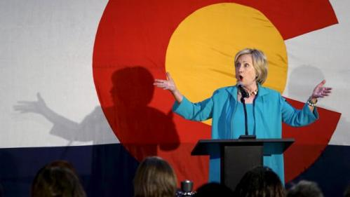 Democratic presidential candidate Hillary Clinton addresses supporters at a campaign kickoff in front of a giant Colorado flag at an event in Denver, Colorado August 4, 2015.    REUTERS/Rick Wilking