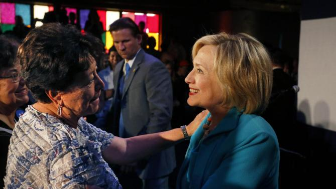 Democratic presidential candidate Hillary Rodham Clinton, right, greets supporters after speaking at a campaign rally at La Rumba, a Denver dance club and restaurant, Tuesday, Aug. 4, 2015. The rally marks Clinton's first presidential campaign event in Denver. (AP Photo/Brennan Linsley)