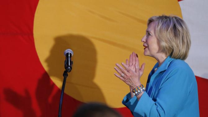 Democratic presidential candidate Hillary Rodham Clinton claps before speaking to supporters during a campaign rally at La Rumba, a Denver dance club and restaurant, Tuesday, Aug. 4, 2015. The rally marks Clinton's first presidential campaign event in Denver. (AP Photo/Brennan Linsley)