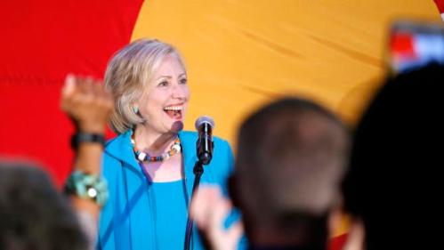 Democratic presidential candidate Hillary Rodham Clinton greets supporters before speaking at a campaign rally at La Rumba, a Denver dance club and restaurant, Tuesday, Aug. 4, 2015. (AP Photo/Brennan Linsley)