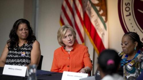 Democratic presidential candidate Hillary Rodham Clinton, center, speaks as she is joined by home care worker Regina Sutton, left, and home care consumer Karen Johnson, right, during a roundtable discussion on home care, Thursday, Aug. 6, 2015, in Los Angeles. (AP Photo/Jae C. Hong)