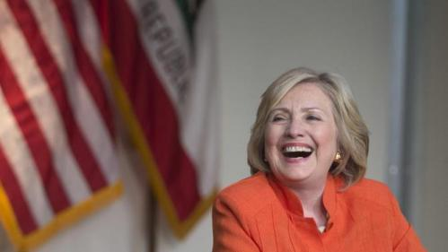Democratic presidential candidate Hillary Rodham Clinton laughs while listening to a home care worker during a roundtable discussion home care, Thursday, Aug. 6, 2015, in Los Angeles. (AP Photo/Jae C. Hong)