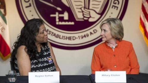 Democratic presidential candidate Hillary Clinton (R) listens to Home Care worker Regina Sutton during a Service Employees International Union roundtable on Home Care at Los Angeles Trade-Technical College in Los Angeles, California August 6, 2015. REUTERS/Mario Anzuoni